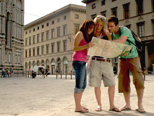 3 people looking at a map